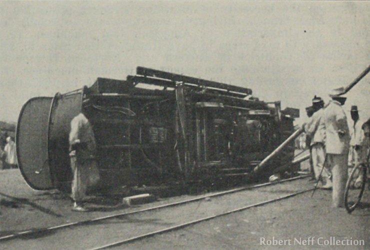 Putting a streetcar back on its tracks, circa 1899.