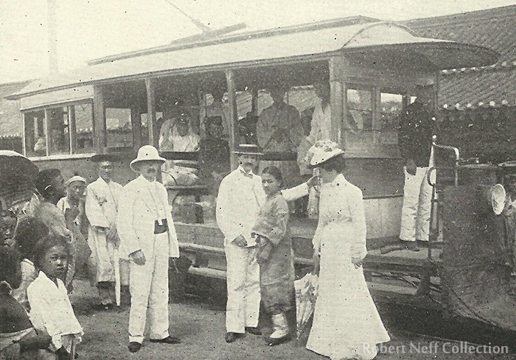 A streetcar with foreigners, circa 1900. Note the cowcatcher placed on the front as a safety measure.