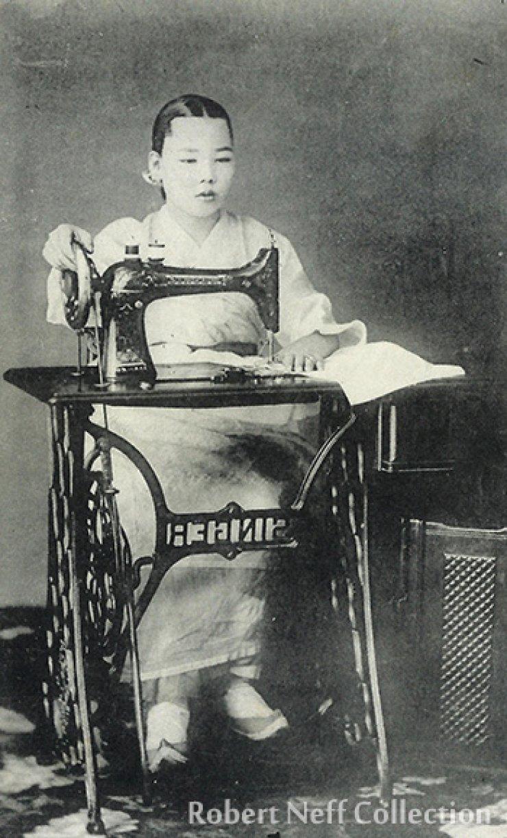 A Korean woman and a sewing machine, circa 1912, Robert Neff Collection.