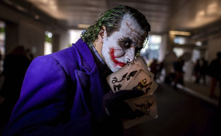 An attendee dressed as the Joker poses during New York Comic Con at the Jacob K. Javits Convention Center on Friday, Oct. 4, 2019, in New York. AP