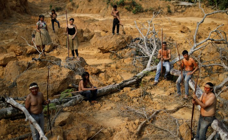 Indigenous people from the Mura tribe show a deforested area in unmarked indigenous lands inside the Amazon rainforest near Humaita, Amazonas State, Brazil August 20, 2019. Picture taken August 20, 2019. Reuters