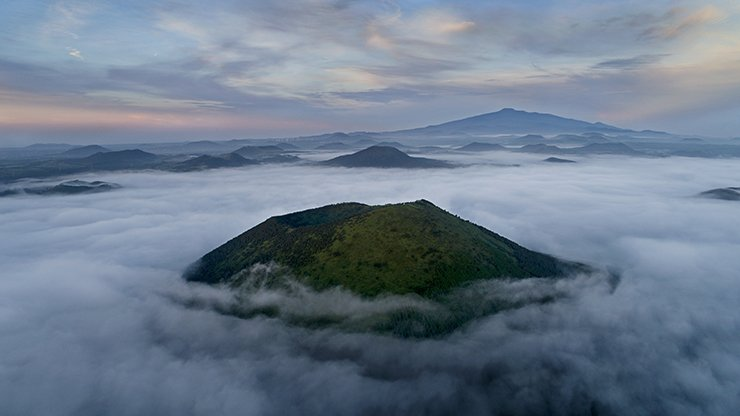 A bird's eye view of Darangshi Oreum, a parasitic volcano that rises 382 meters above sea level, is located in the northeastern part of Jeju Island. The aerial views were captured from a drone camera. Courtesy of Choi Jae-young