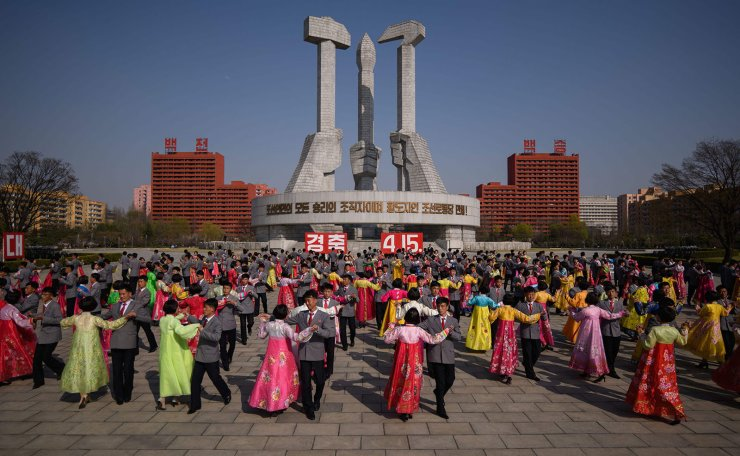 Students participate in a mass dance performance as part of celebrations marking the anniversary of the birth of late North Korean leader Kim Il Sung, known as the 'Day of the Sun', at the Monument to the Worker's Party Founding, in Pyongyang on April 15, 2019.  AFP