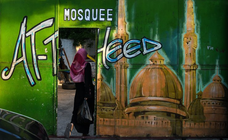 A Muslim woman renters the Masjid At-Tawheed mosque on the first day of the Muslim holy month of Ramadan in Port-au-Prince on May 6, 2019. AFP
