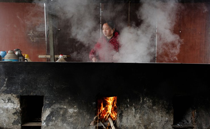 <span>Jiejie Li, wife of 32-year-old fisherman Sun Lianxi, prepares food on a wood stove in their makeshift dwelling at the Yellow River embankment of on the northern outskirts of Zhengzhou, Henan province, China, February 21, 2019. For generations, the Suns plied their fishing boats up and down the Huai and Yellow Rivers, living off their daily catch. Like their grandfather and father before them, brothers Sun Genxi, 44, and Sun Lianxi were born on a fishing boat. China's economic ascent has tantalised the brothers. Reuters</span><br /><br />