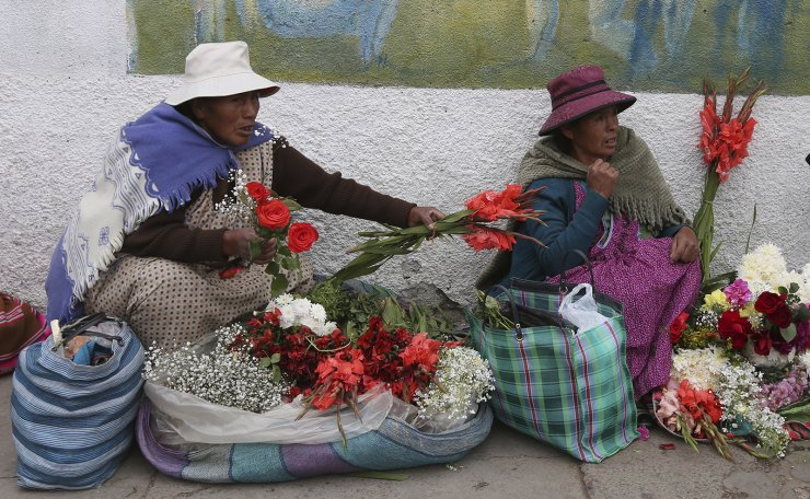 Women sells flowers outside the General Cemetery in La Paz, Bolivia, Monday, March 18, 2019. AP