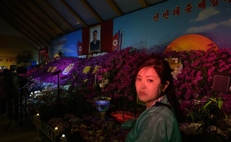 In a photo taken on April 12, 2019 a portrait of late North Korean leader Kim Il Sung is displayed as attendees visit a 'Kimilsungia' flower show as part of celebrations marking the 'Day of the Sun', in Pyongyang. AFP