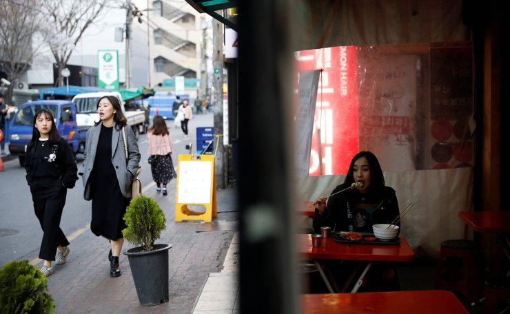 Japanese Yuuka Hasumi, 17,  who wants to become a K-pop star, eats 'Tteok-bokki' after class, in the Hongdae area of Seoul, South Korea, April 3, 2019. Reuters