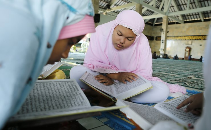 Muslim girls read the Quran at a mosque during the first day of the holy fasting month of Ramadan, Monday, May 6, 2019, in Bali, Indonesia. AP
