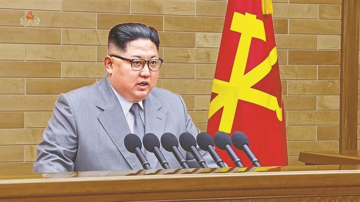North Korean leader Kim Jong-un speaks in his annual address in an undisclosed location in North Korea in this image made from a video released Monday. / Yonhap