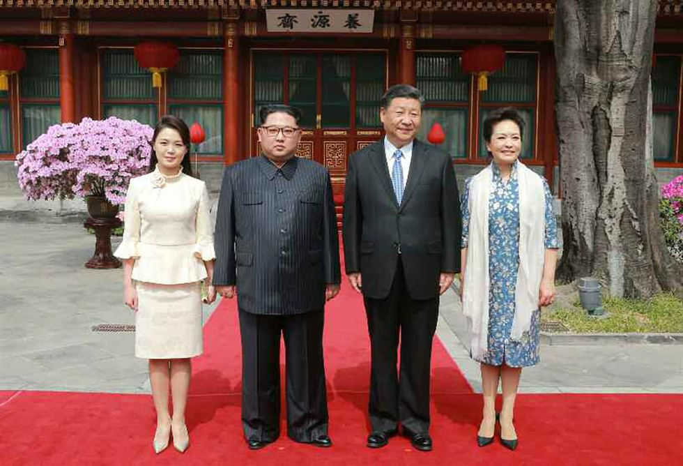 North Korea's first lady Ri Sol-ju sports a Chanel look in this photo with her husband Kim Jong-un and the Chinese first couple, Xi Jinping and Peng Liyuan. / Yonhap