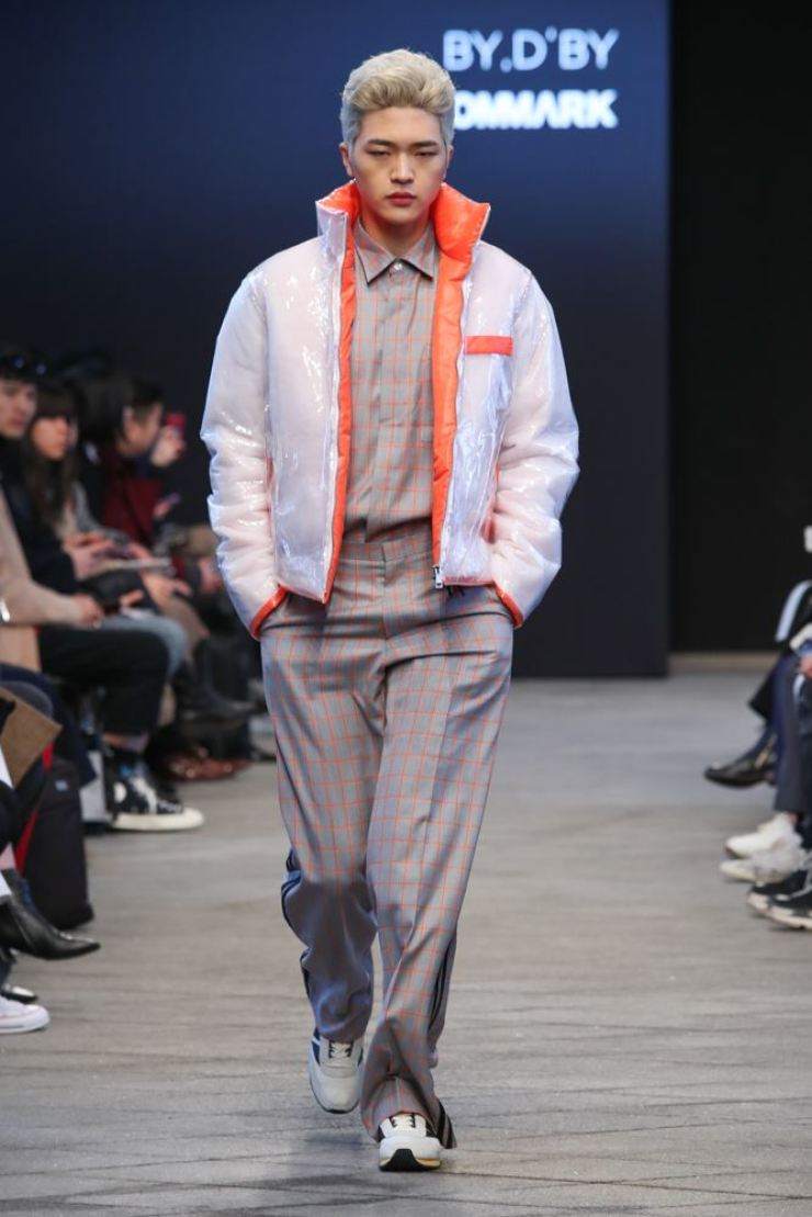A model wears a creation by By D By's 2018 fall and winter collection at the HERA Seoul Fashion Week at Dongdaemun Design Plaza in Seoul, Wednesday. / Courtesy of Seoul Design Foundation