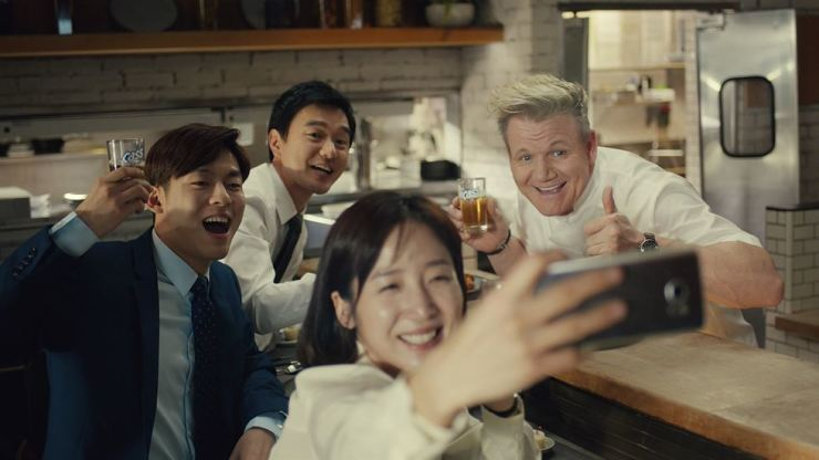 Gordon Ramsay, right, in his second venture to star in Cass commercials that were released on Mar. 5. / Courtesy of Oriental Brewery
