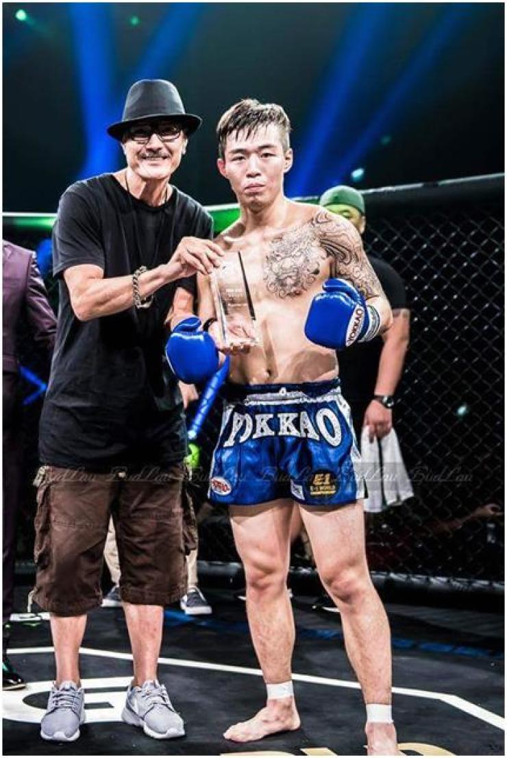 Woo Seung-bum, team Korea's Muay Thai champion, poses during Hong Kong's hybrid MMA, K1 and Muay Thai promotion E-1 World Championship in this 2016 file photo. / Courtesy of Samsan Muay Thai
