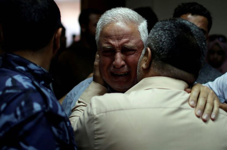 A relative of Palestinian Ahmed al-Rantisi, who was killed during a protest at the Israel-Gaza border, is consoled at a hospital in the northern Gaza Strip May 14, 2018. / REUTERS