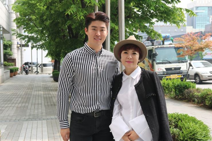 Fashion designer Grace Moon, right, and her son Joshua pose in western Seoul last Monday. / Korea Times