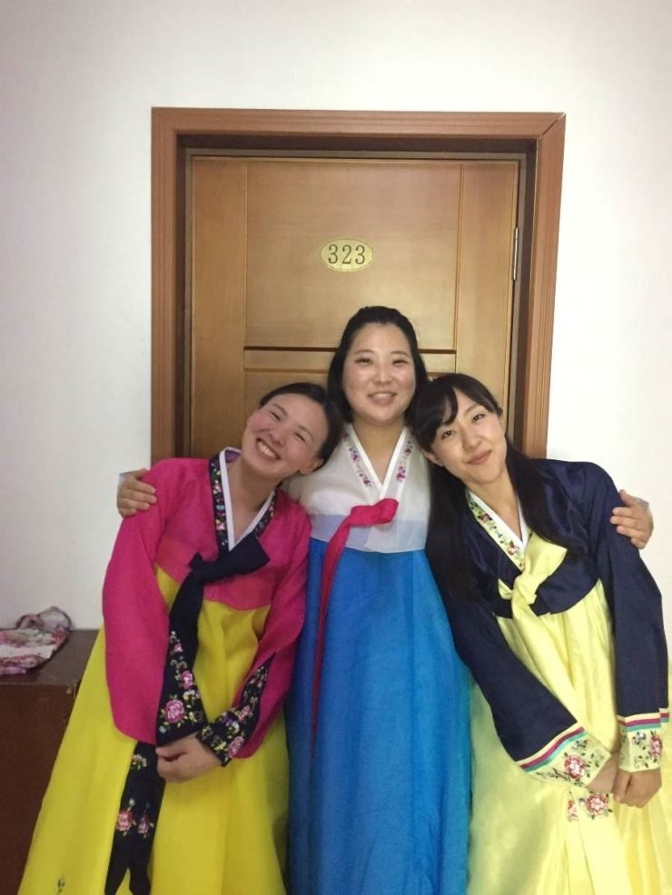 Kim Yun-ok, center, poses in traditional Korean clothes with her friends. / Courtesy of Kim Yun-ok