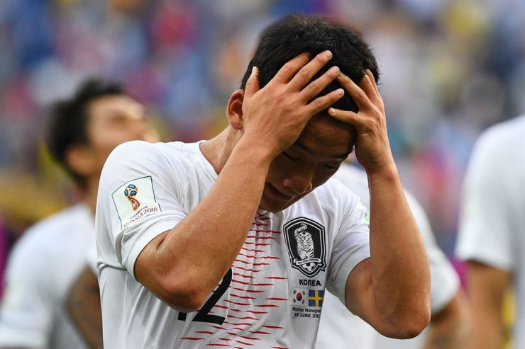 South Korea's midfielder Kim Min-woo reacts to the defeat following the Russia 2018 World Cup Group F football match between Sweden and South Korea at the Nizhny Novgorod Stadium in Nizhny Novgorod on June 18, 2018. / AFP