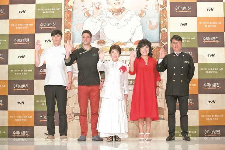 The cast of tvN's new cooking show 'Soo-mi's Side Dishes' wave at Amoris Hall in Yeongdeungpo-gu, Seoul, on Friday. Courtesy of CJ E&M