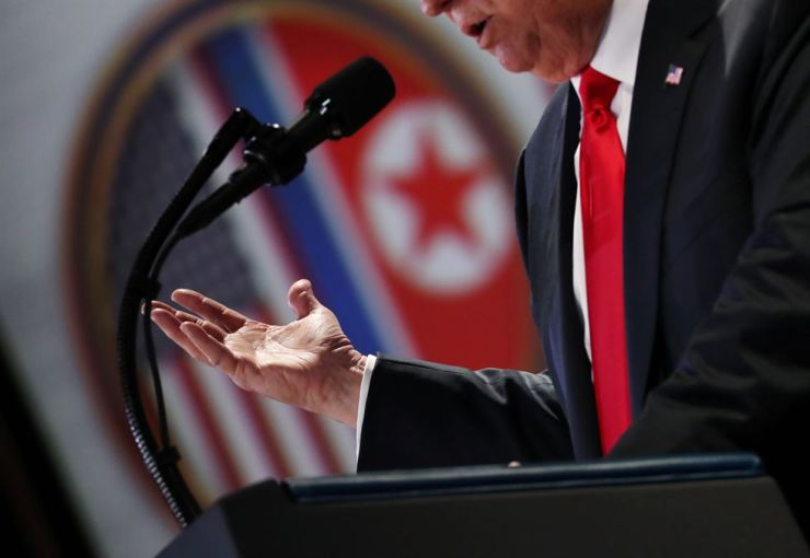 U.S. President Donald Trump speaks during a news conference after his meeting with North Korean leader Kim Jong-un at the Capella Hotel on Sentosa Island in Singapore, Tuesday. Reuters