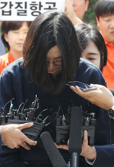 Lee Myung-hee, the wife of Korean Air Chairman Cho Yang-ho, speaks before entering the Seoul Central District Court for a hearing to review an arrest warrant request on charges she abused employees. / Yonhap