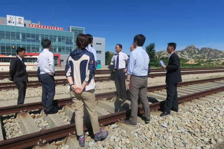 Officials of South and North Korea check the condition of tracks at Kamho Station in the North, Friday. / Courtesy of Unification Ministry