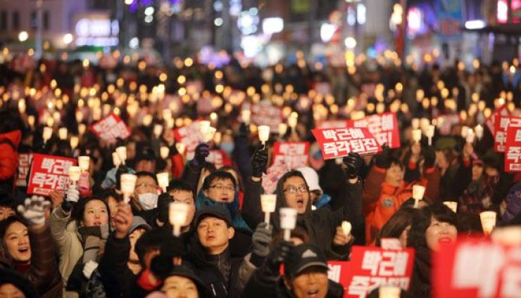 Thousands joined candlelight demonstrations across the country. Yonhap