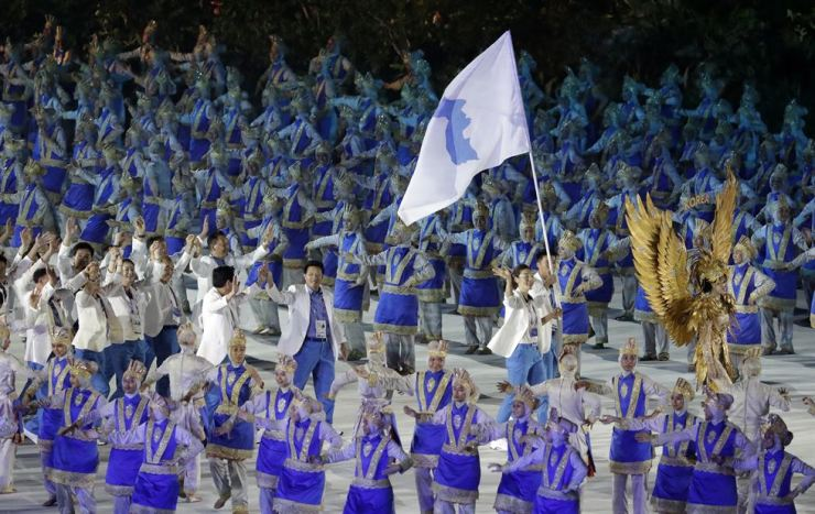 The combined Koreas march into Gelora Bung Karno Stadium under the 'unification' flag during the opening ceremony for the 18th Asian Games in Jakarta, Indonesia, Saturday, Aug. 18, 2018. / AP