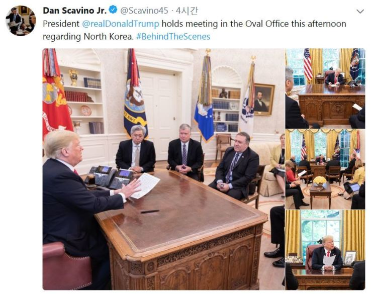 In an image captured from a tweet by Dan Scavino Jr., the White House director of social media, U.S. President Donald Trump, left and officials involved in North Korea discuss the situation in Washington, Saturday (KST). / Yonhap