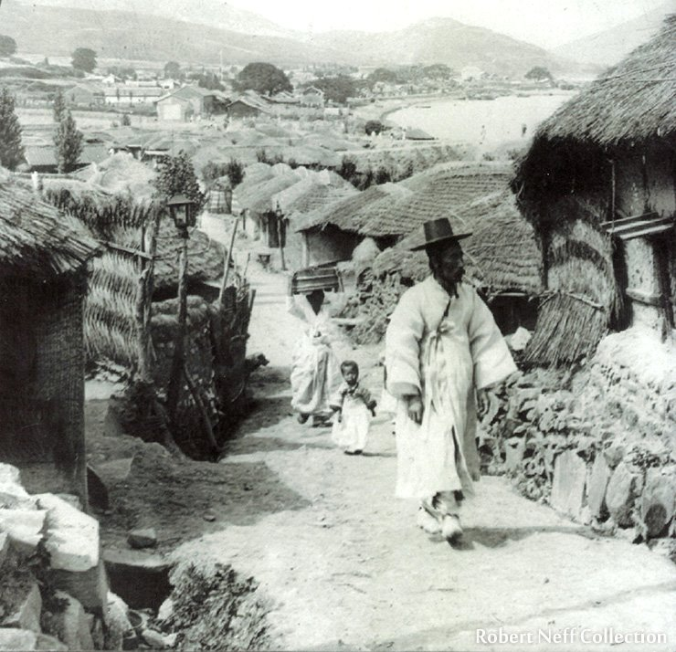 People-watching on a small street in Busan, 1903.