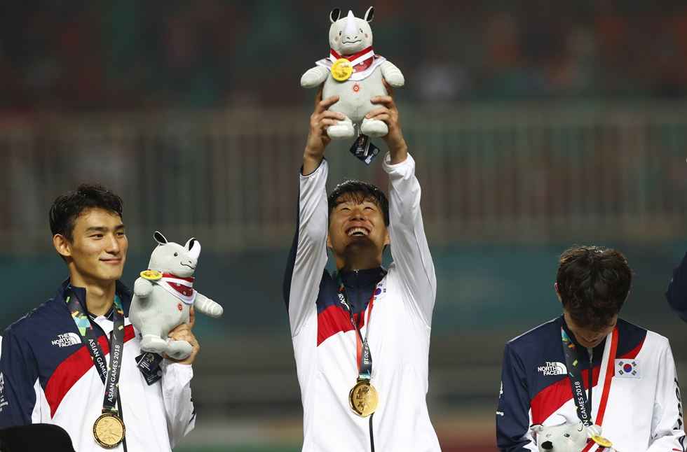 Son Heung-min celebrates on the podium after defeating Japan in the men's soccer gold medal match at the 18th Asian Games in Bogor, Indonesia, Saturday. AP