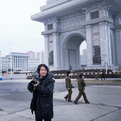 A North Korean traffic lady, who marshals vehicles at the intersections of North Korea's capital city, smiles in this photo taken by Japanese photographer Hatsuzawa Ari in 2016.
