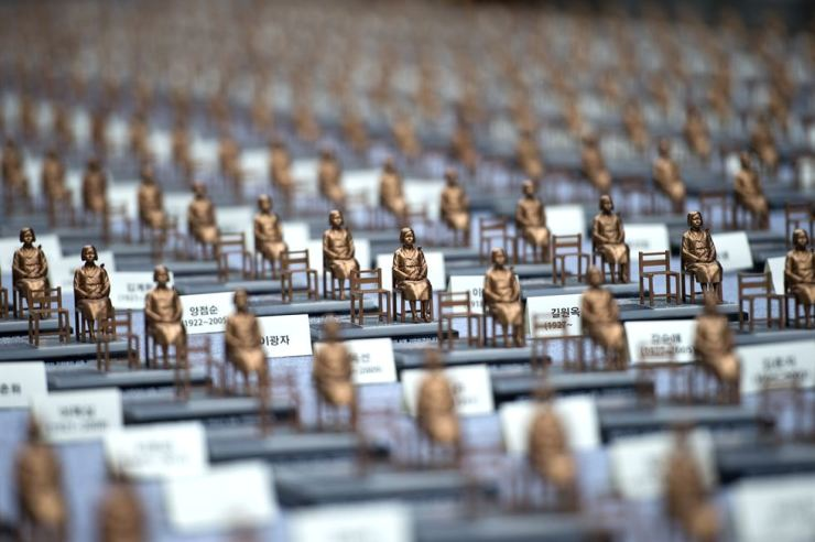 Miniature figures of women who were forced to provide sex by the Japanese government during World War II. Korea Times file.