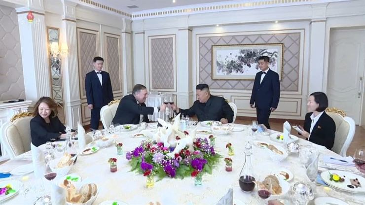 North Korean leader Kim Jong-un and the U.S. Secretary of State raise their glasses during Mike Pompeo's recent visit to Pyongyang. Pompeo said the North would allow outside nuclear inspectors. Yonhap