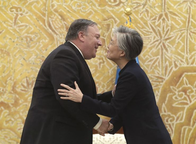 Foreign Minister Kang Kyung-wha greets U.S. Secretary of State Mike Pompeo before Pompeo's meeting with President Moon Jae-in at Cheong Wa Dae in Seoul on Sunday, Oct. 7. That was after Pompeo's supposedly expletive-using outburst. AP-Yonhap
