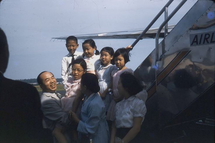 Rev. Jacob Siung-tuk Kim holds his second daughter Sun-hwa in this photo taken on June 5, 1958, at Washington National Airport, now Ronald Reagan National Airport outside Washington, D.C. The Kim family was reunited after a decade of separation. / Courtesy of Eugenia Kim