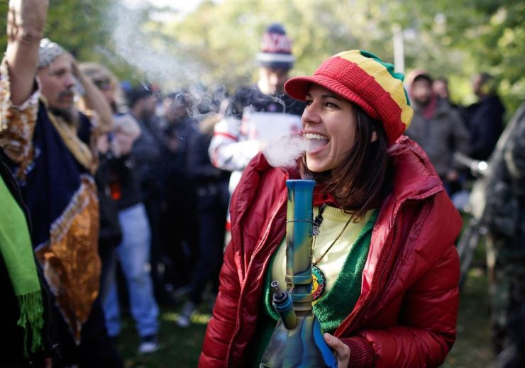 A Toronto woman smokes a bong on the day Canada legalized recreational marijuana on Oct. 17. Reuters