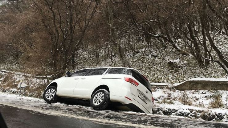 A car is stuck in the ditch next to a road on Jeju Island in this 2017 photo. The police found the driver made a mistake due to inexperience. / Courtesy of Jeju Provincial Police Agency