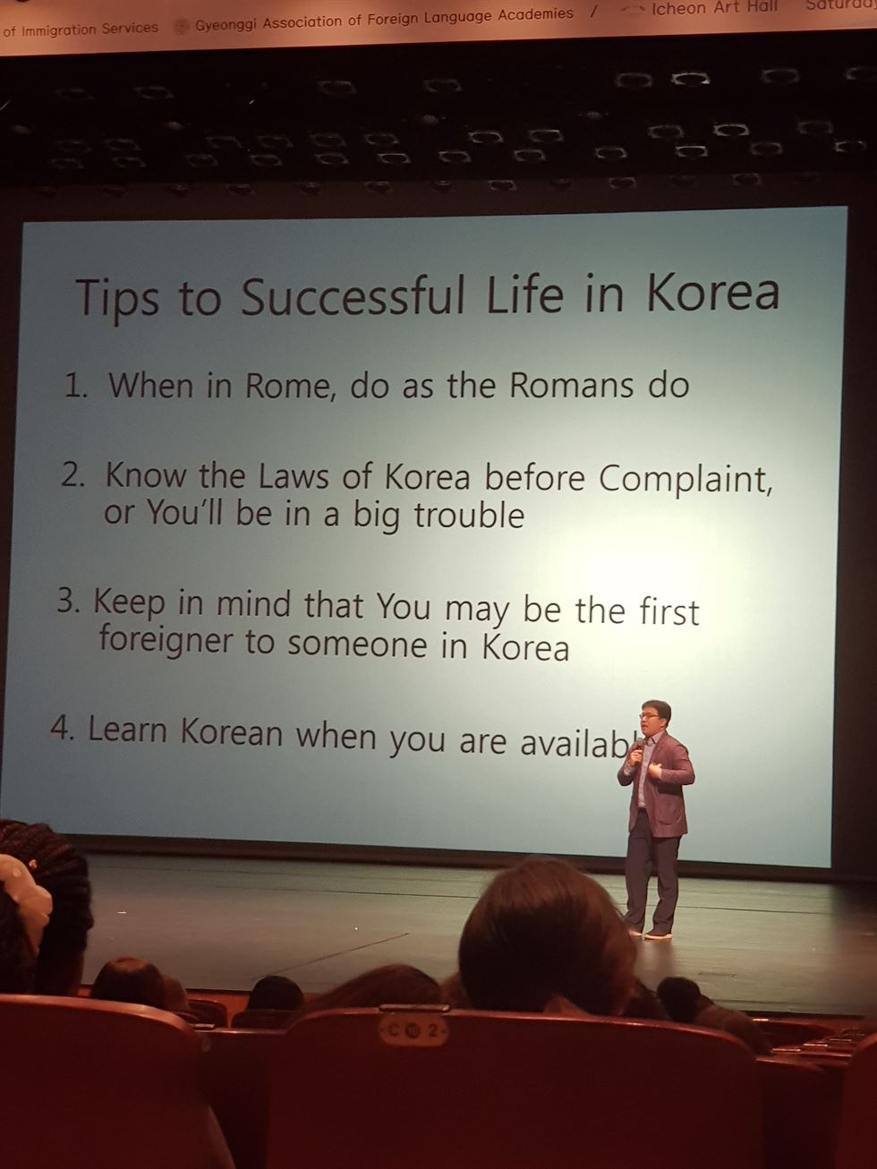 Attendees of a mandatory seminar for foreign English teachers in Gyeonggi Province on Oct. 20 stand for the Korean national anthem. / Courtesy of Joe McPherson