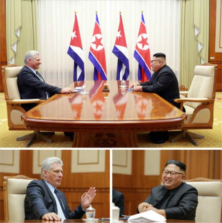 Kim Jong-un and Miguel Diaz-Canel discuss ties between the two countries at the Paekhwawon State Guest House on Sunday. Yonhap-Rodong Sinmun