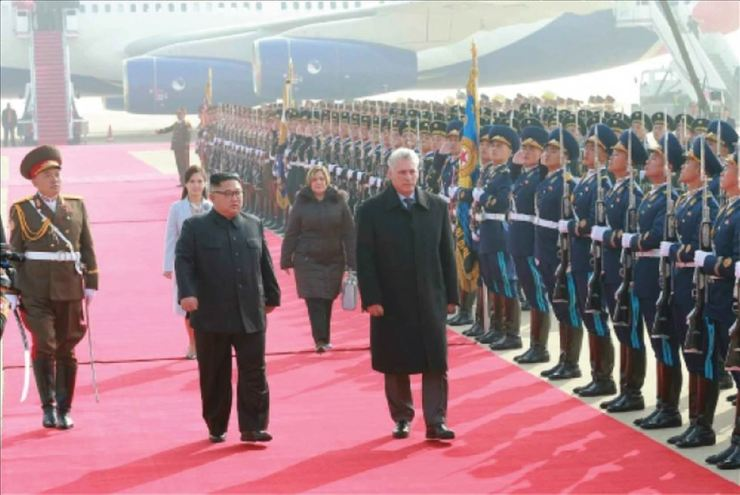 North Korean leader Kim Jong-un and Cuban President Miguel Diaz-Canel review the honor guard of the Korean People's Army (KPA), followed by North Korea's first lady Ri Sol-ju and her Cuban counterpart Lis Cuesta Peraza, Sunday at Pyongyang International Airport. Yonhap-KCNA
