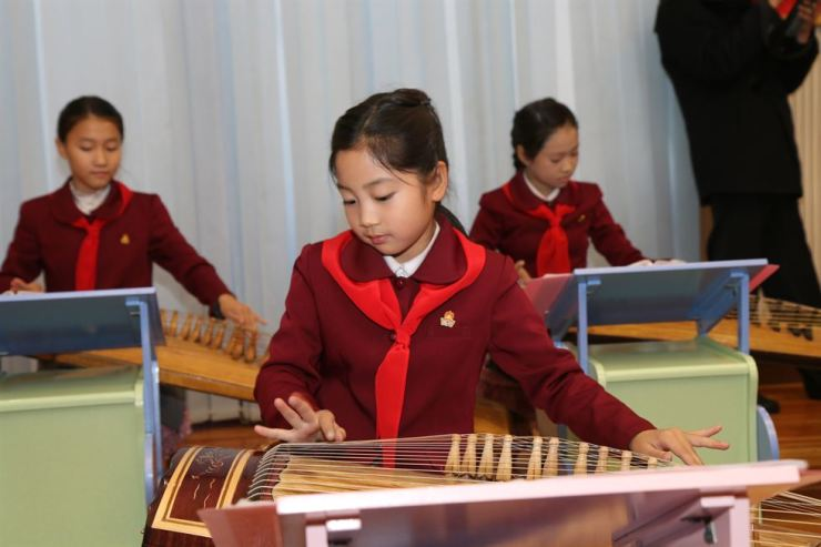 Students play the gayageum at the Mangyongdae Children's Palace in Pyongyang, Thursday.