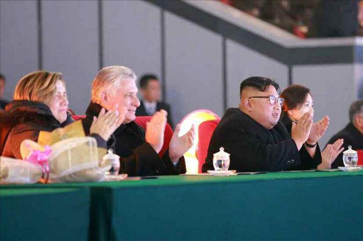 The two leaders and the first ladies attend a mass gymnastics performance at the May Day Stadium, Monday. Yonhap-Rodong Sinmun