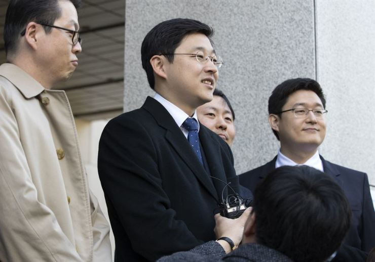 Conscientious objector Oh Seung-hun talks to reporters outside the Supreme Court, southern Seoul, Thursday, after the court overturned a lower court ruling that found Lee guilty of breaking the country's military draft law for refusing mandatory military service. / Yonhap