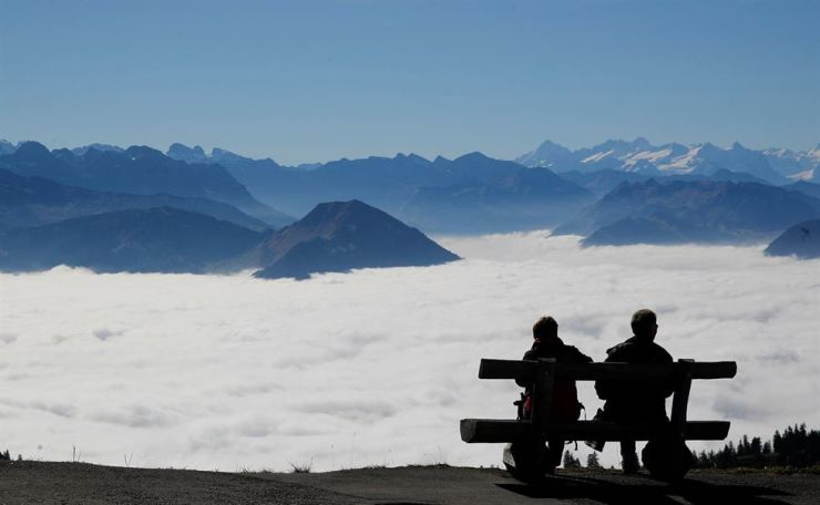 Tourists enjoy the view over fog-covered valleys during sunny weather near the peak of Mount Rigi, Switzerland, Oct. 22. Reuters