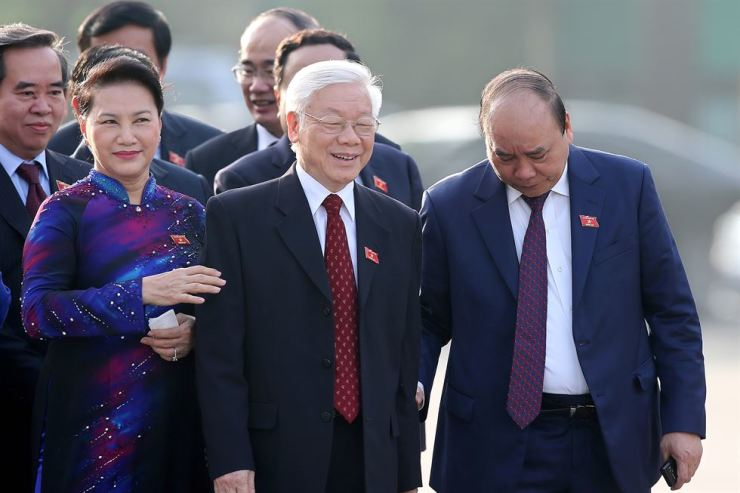 Vietnam's General Secretary Nguyen Phu Trong (C), Vietnam's Chairwoman of the National Assembly Nguyen Thi Kim Ngan (L), Vietnam's Prime Minister Nguyen Xuan Phuc (R) smile as they attend a wreath laying ceremony ahead of the sixth session of the 14th National Assembly in Hanoi, Vietnam, 22 October 2018. EPA-Yonhap