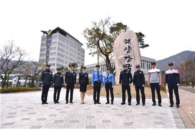 Models wearing new uniforms for the Coast Guard pose in front of Korea Coast Guard headquarters in Incheon on Nov. 26. The new uniforms were unveiled on the occasion of the relocation of Coast Guard 1 from Sejong City to the port city near the West Sea. / Courtesy of Korea Coast Guard