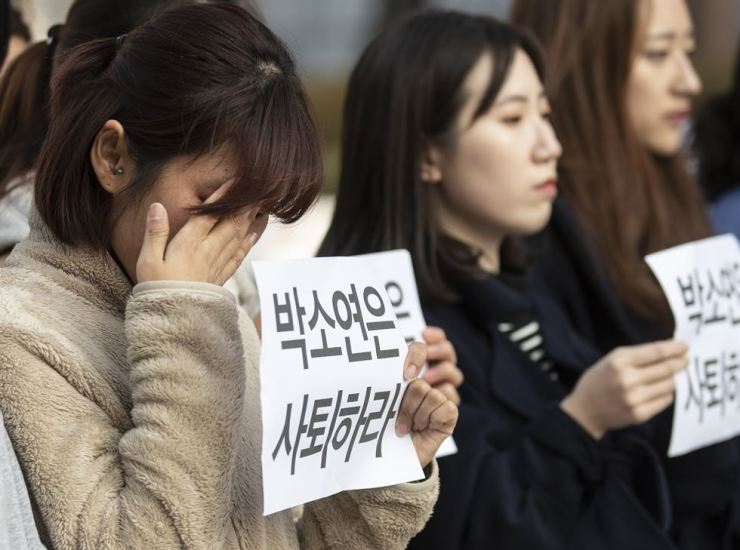 A woman sheds tears as CARE officials call on its leader, Park So-youn, to resign for allegedly euthanizing more than 200 dogs and cats without telling them the truth, during their protest in central Seoul, Jan. 12. Yonhap