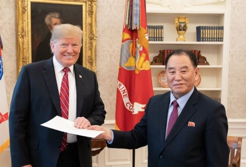 North Korean leader Kim Jong-un receives reports on the result of the recent U.S. visit by North Korean nuclear envoy Kim Yong-chul, at an office in Pyongyang, in this photo released by the Korean Central News Agency on Thursday. / Yonhap