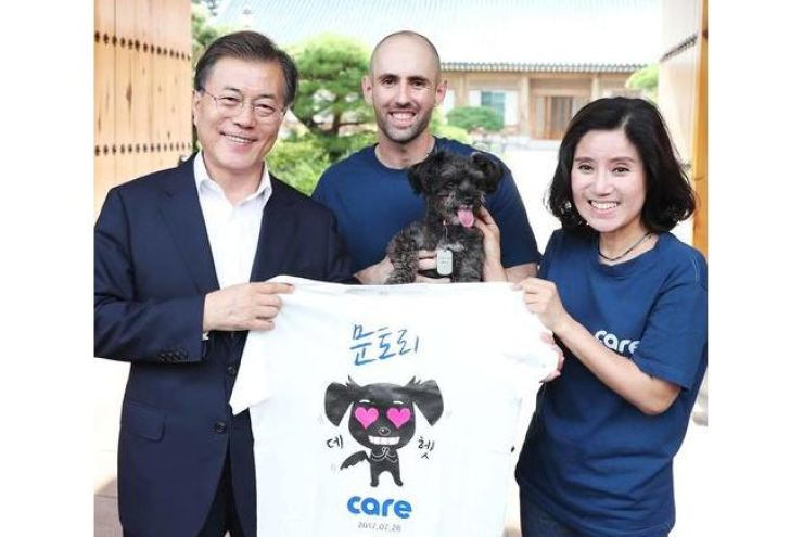 President Moon Jae-in adopted Tori, a dog rescued by CARE, soon after being sworn into office in 2017. Courtesy of CARE